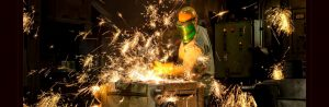 foundry worker sparks flying