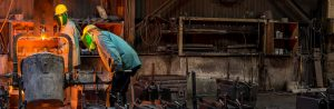 2 foundry workers pouring castings